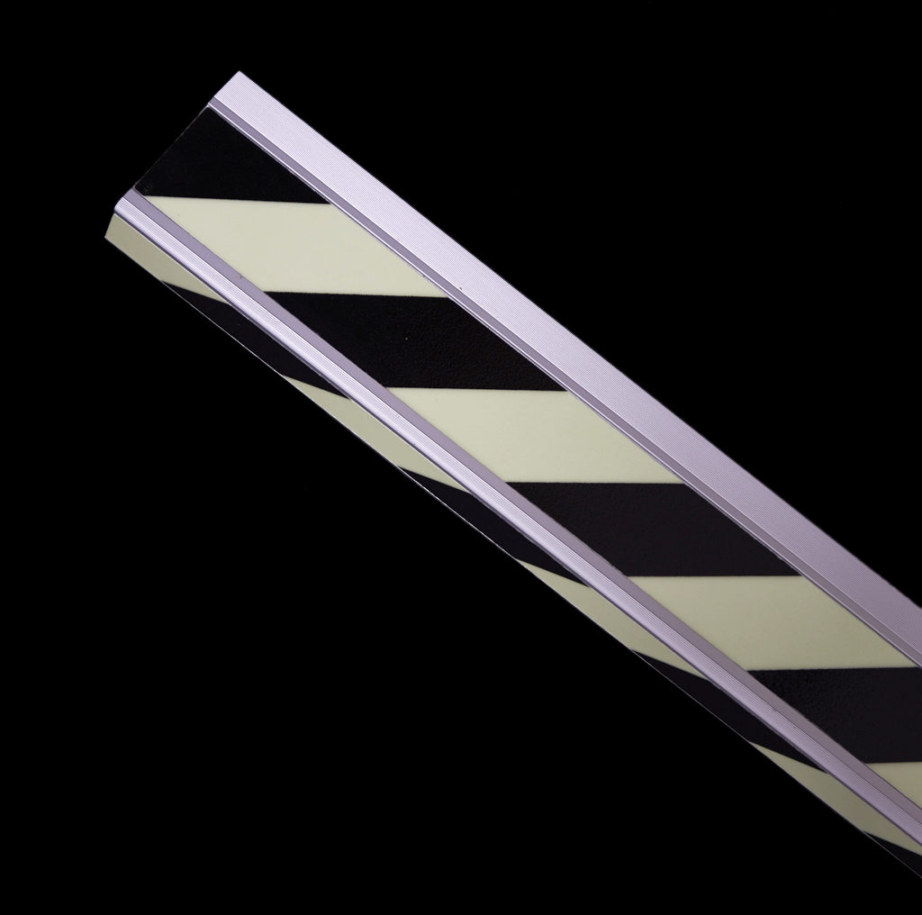 Striped photoluminescent stair profiles