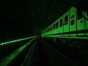 Tunnel lighting photoluminescent, photoluminescent signage, infrastructure lighting