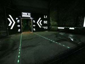 Tunnel lighting photoluminescent, photoluminescent signage, infrastructure lighting
