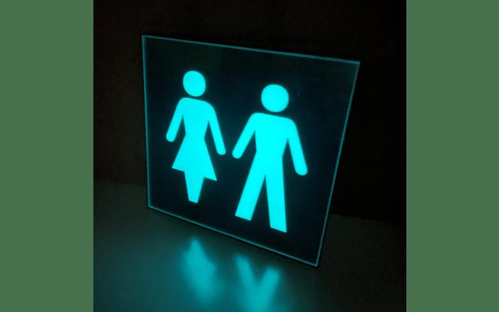 Glow in the dark toilet sign